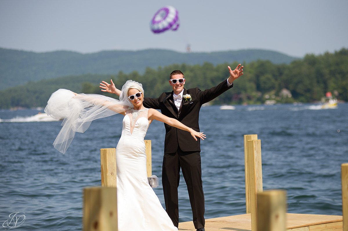 fun bride and groom photo on dock on lake lake george
