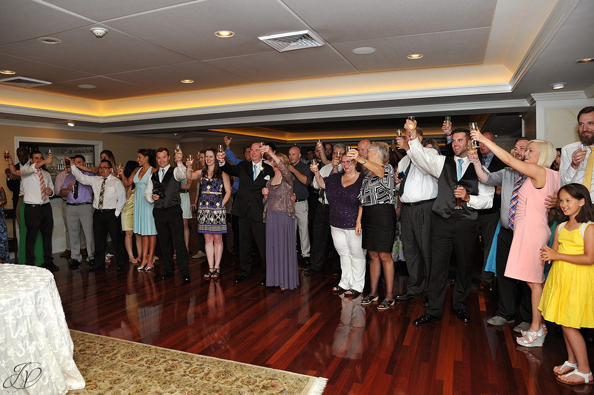 guests toast bride and groom during wedding reception