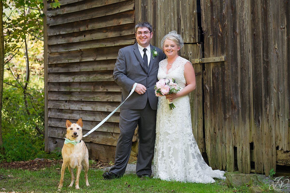 cute shot of bride and groom with their dog