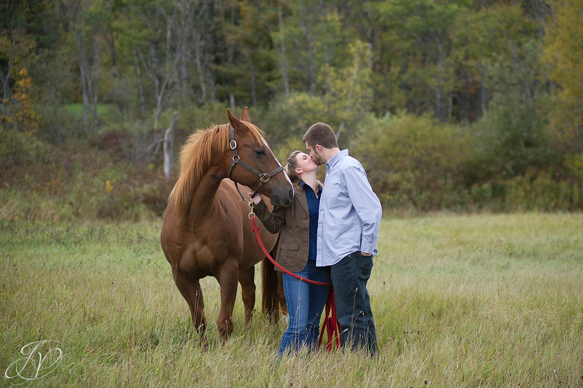Saratoga Springs Engagement Photographer, Albany Engagement photography, Newly engaged photos, Saratoga portrait photographer, couple kissing with horse