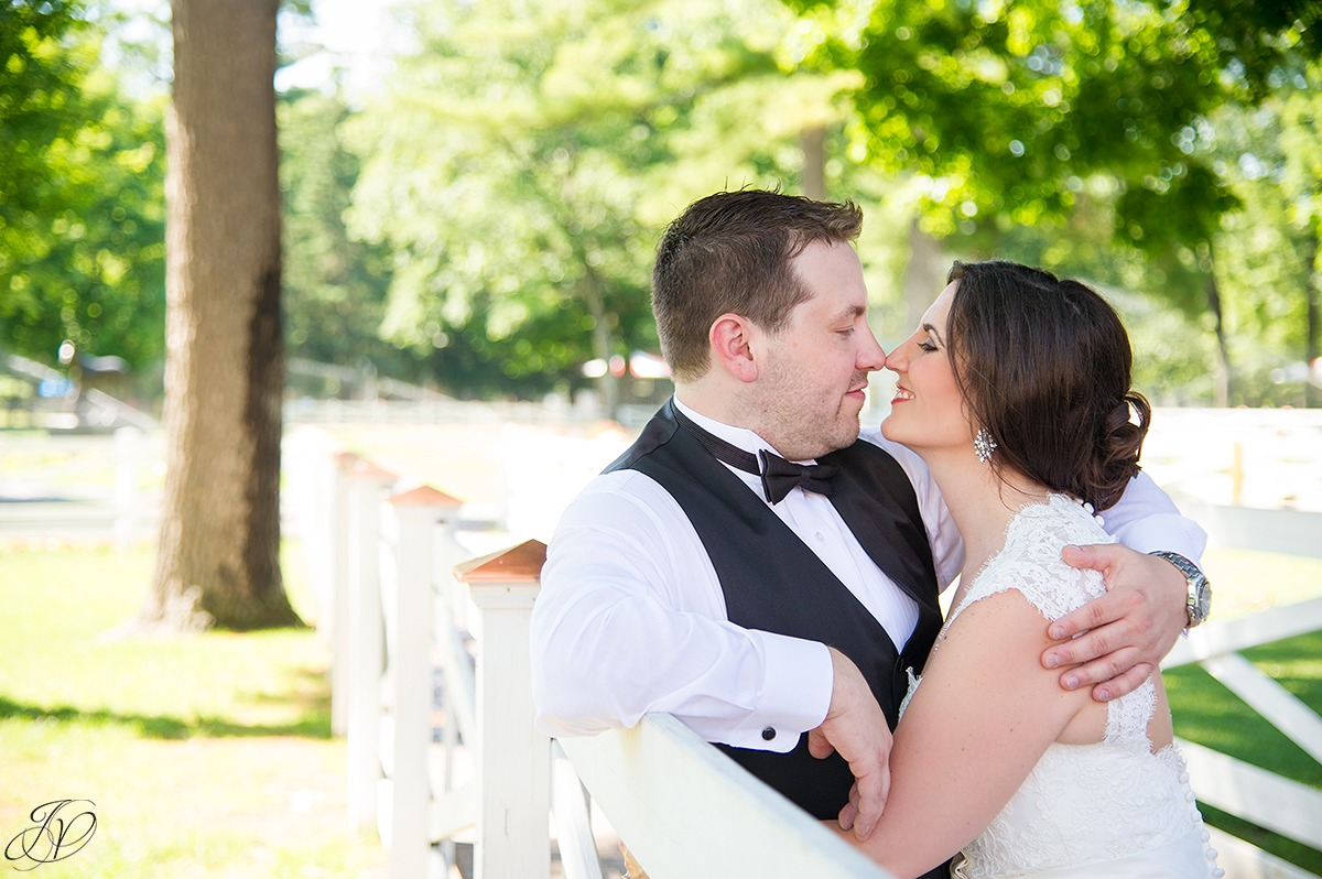 romantic photo of bride and groom at saratoga racetrack