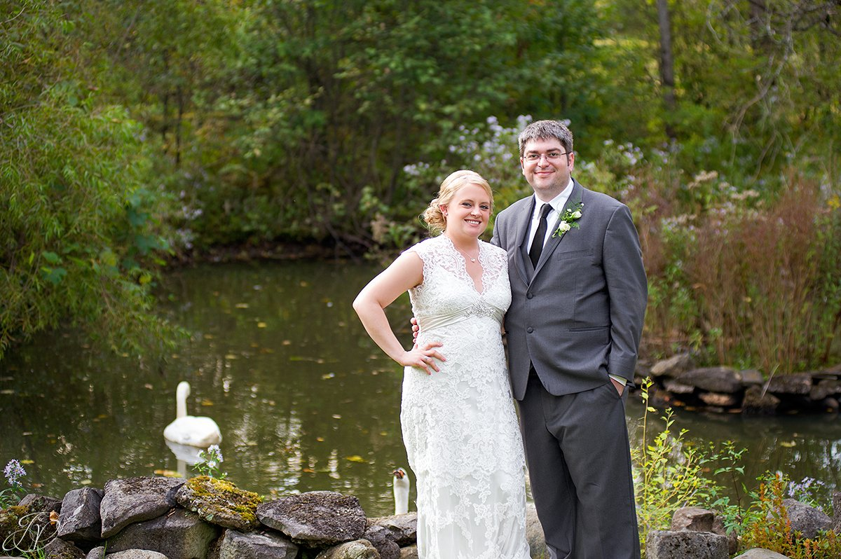 vintage photo of bride and groom in front of pond