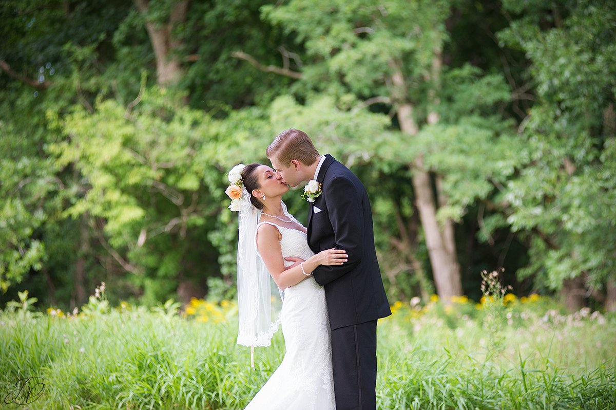 bride and groom kissing normanside country club