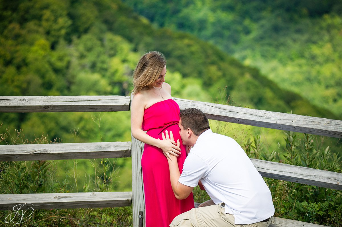 father kissing mother stomache, albany maternity photography, albany maternity photographer, john boyd thacher state park