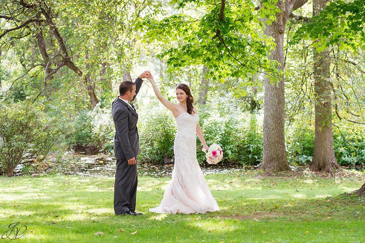 photo of groom twirling his bride