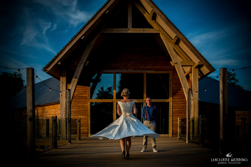 Bride spinning in her wedding dress at The Mill Barns