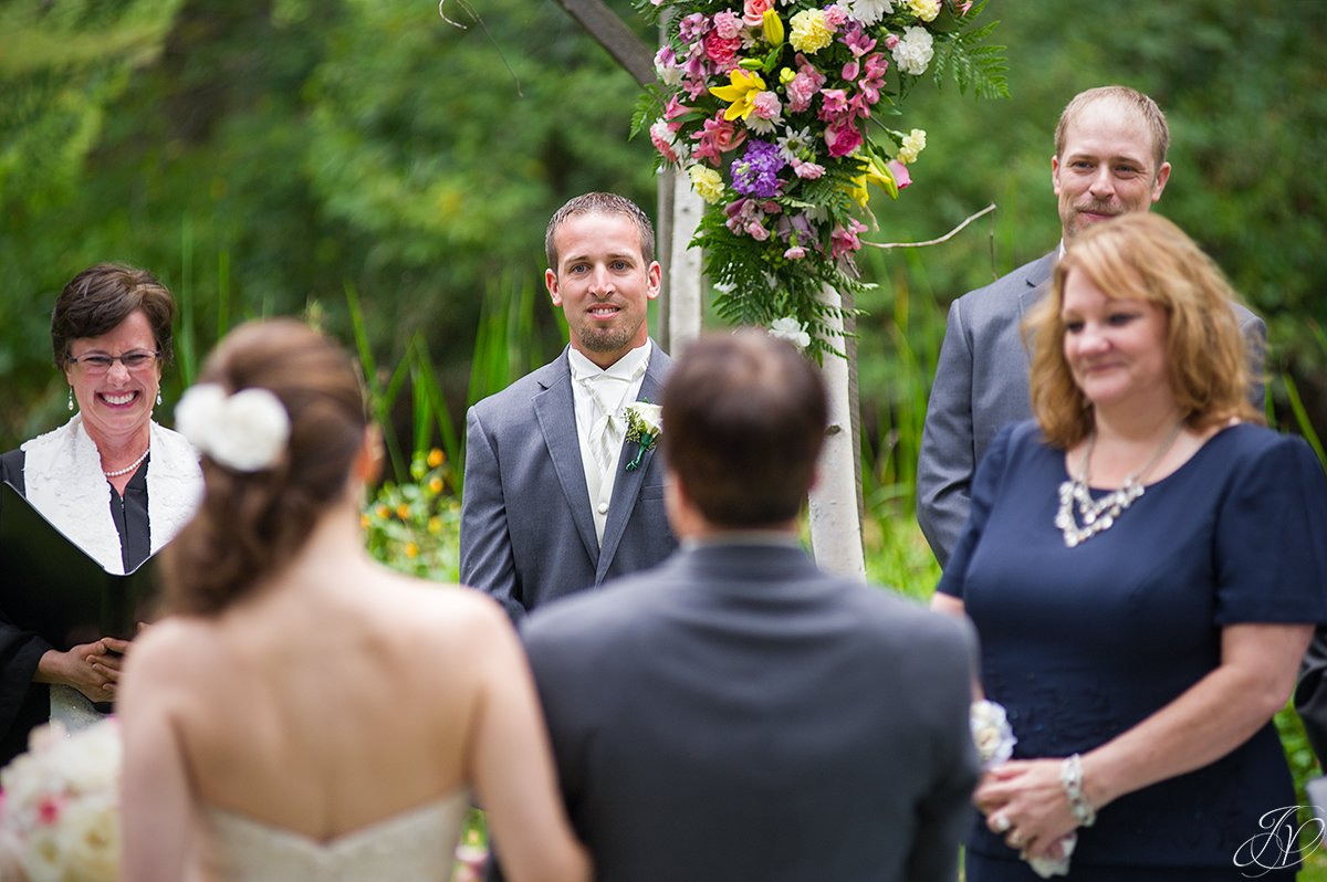 emotional bride and groom first glance during ceremony
