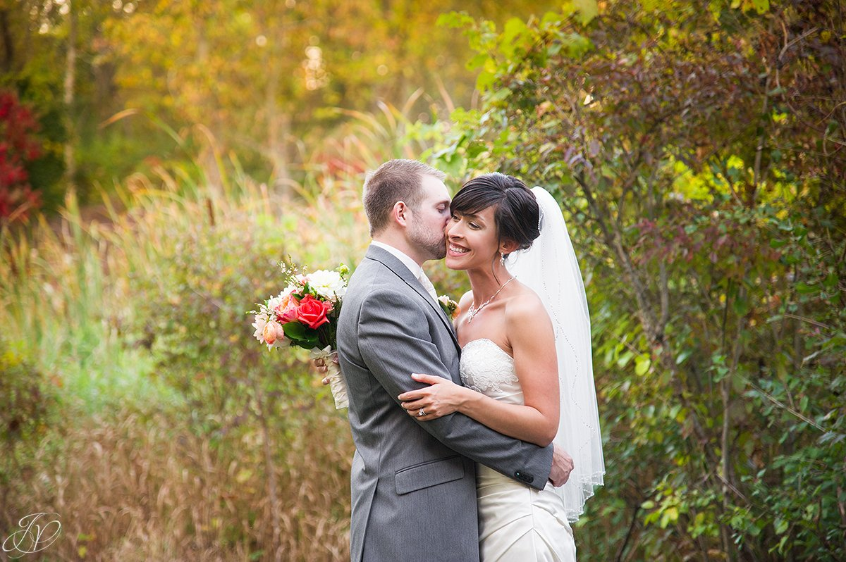 beautiful image of bride and groom in the fall
