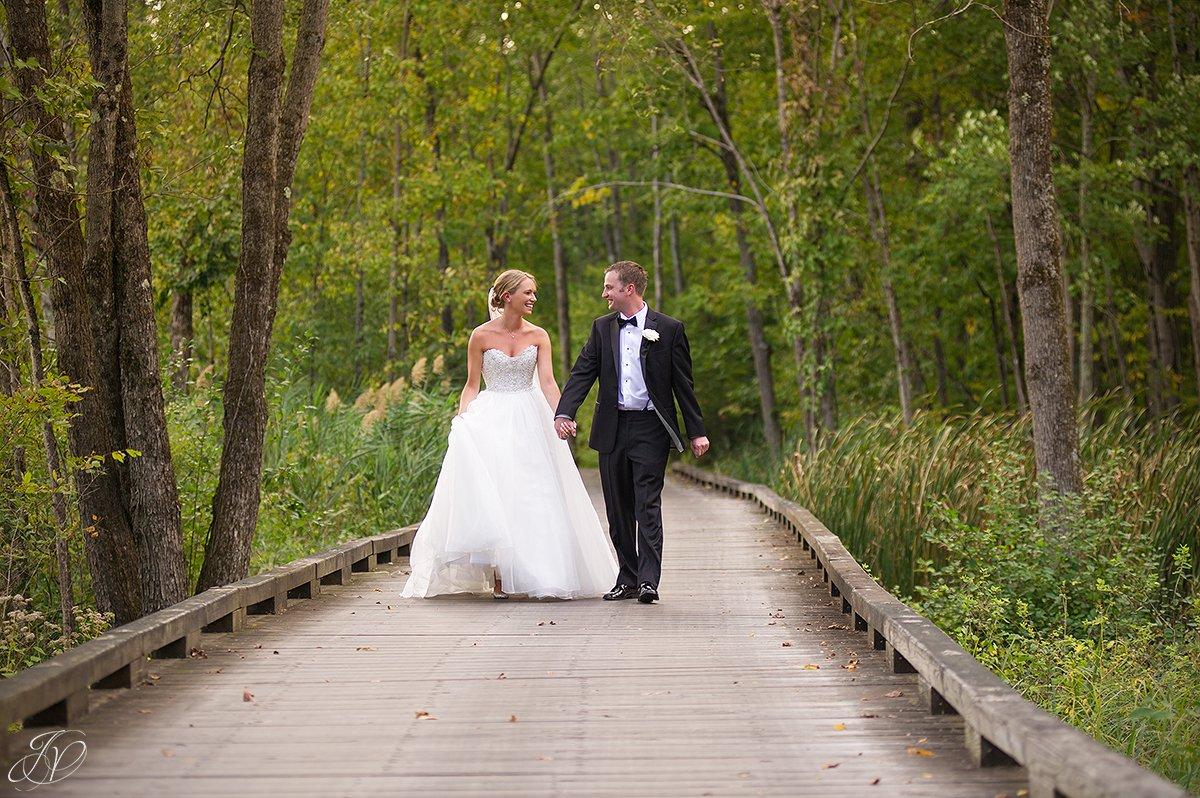 bride and groom on bridge walkway saratoga national