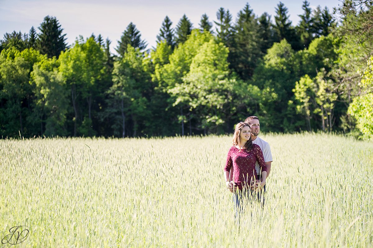 summer photo of couple in a field