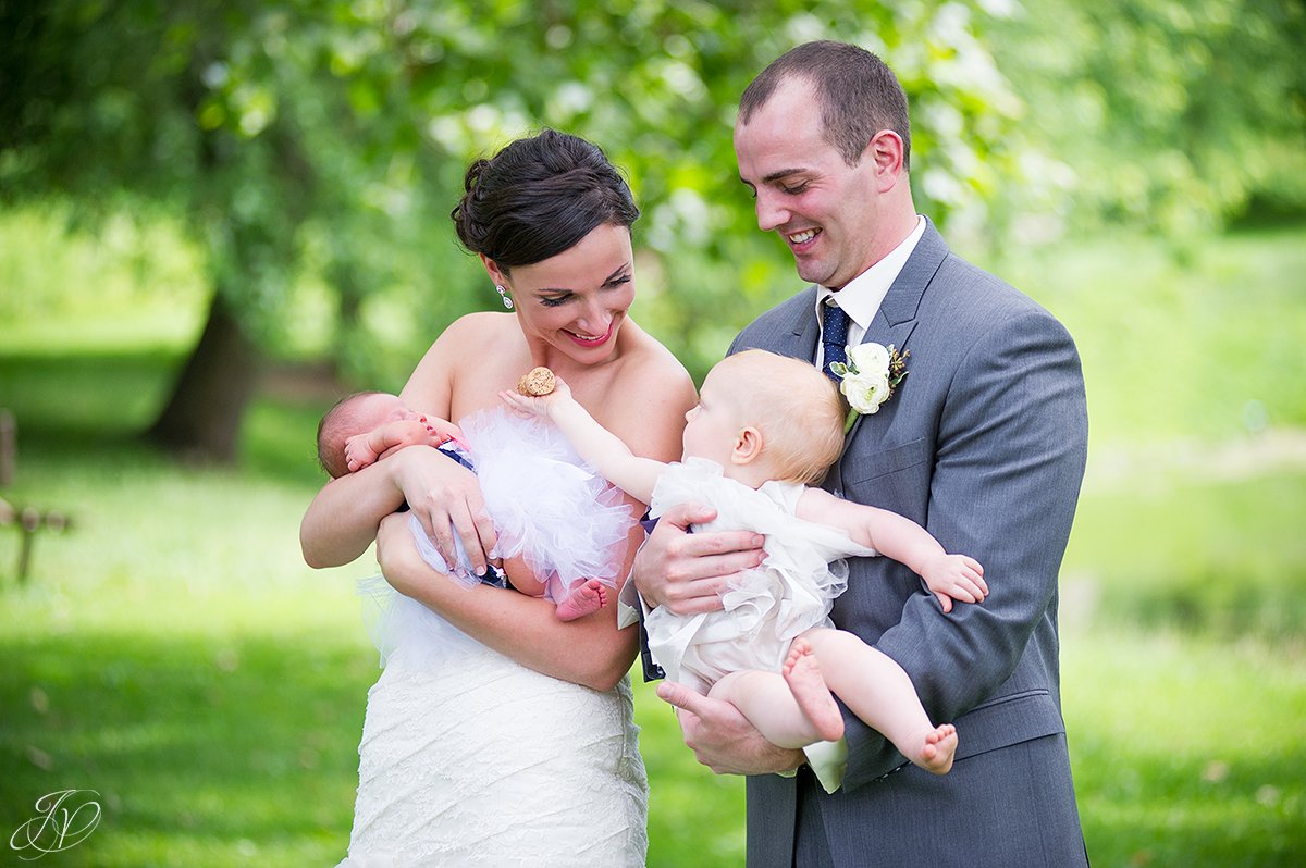 cute shot of bride and groom with baby nieces