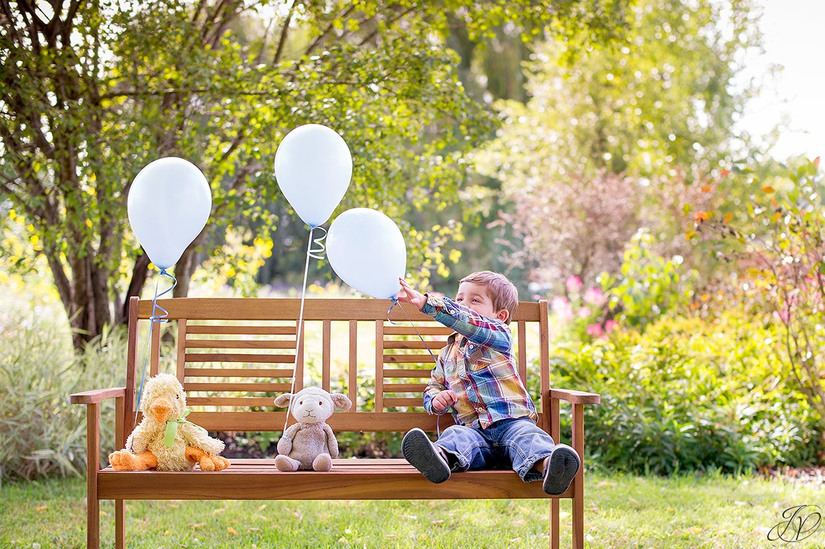 two year old portrait session balloons children