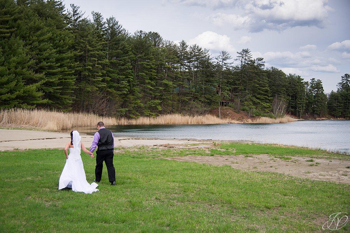 bride and groom walking to beach