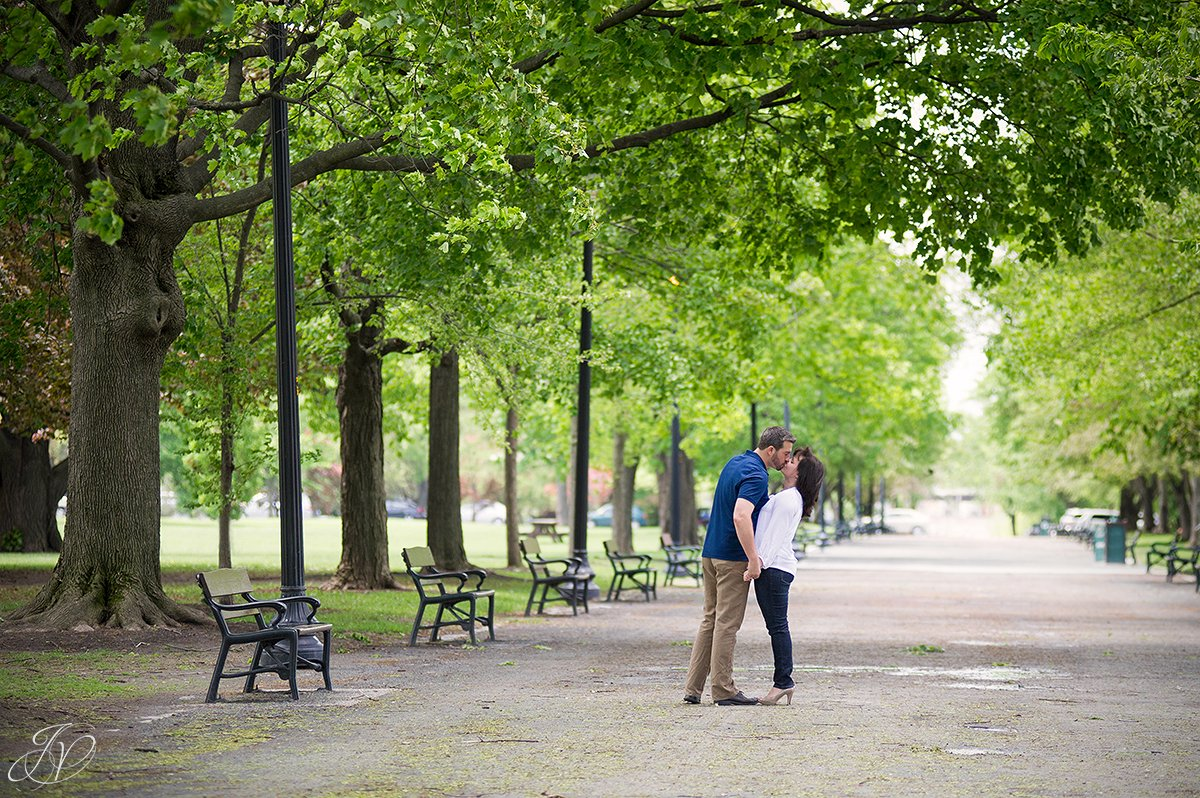 romantic couple kissing in park