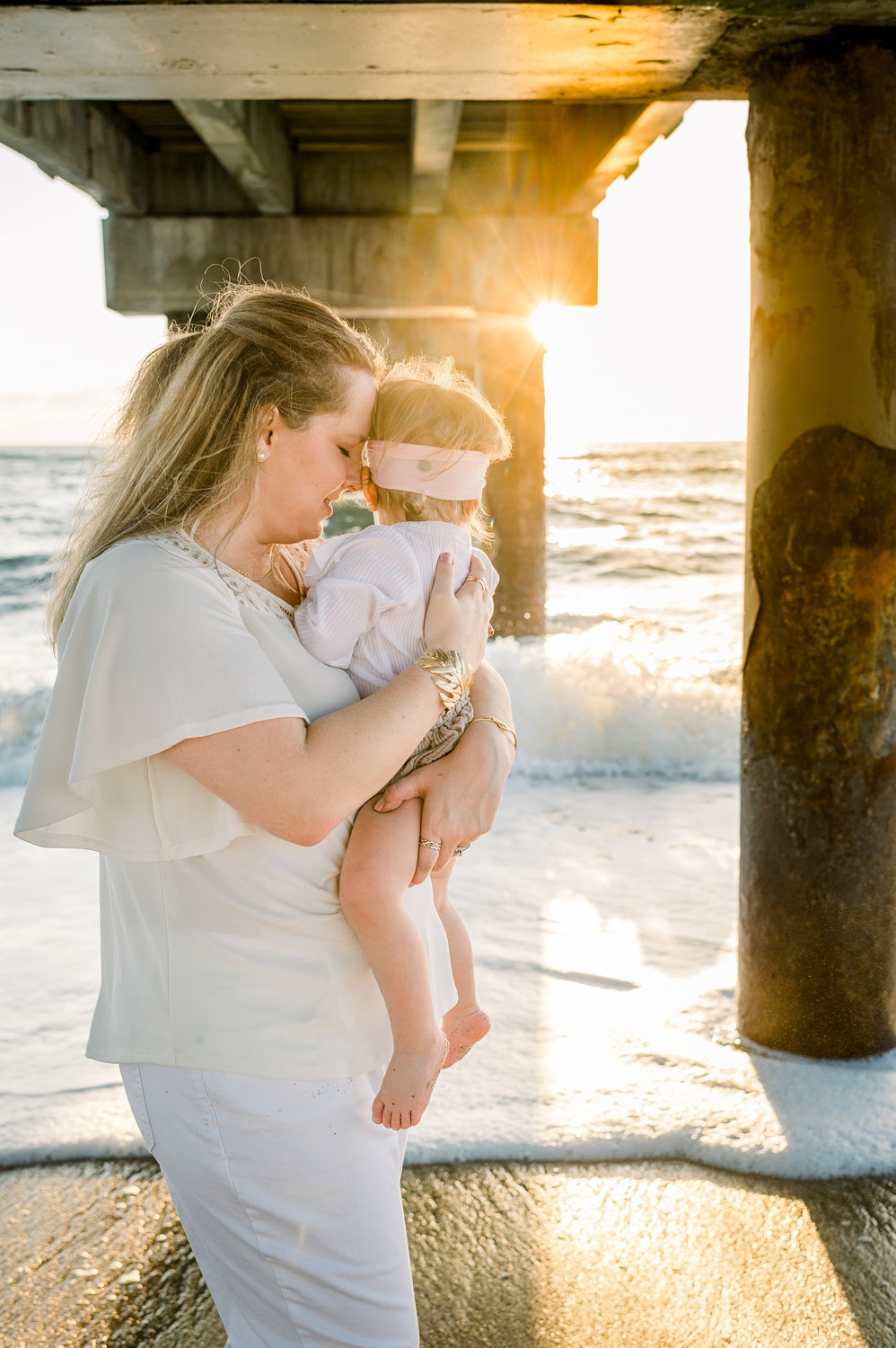 mother cradling daughter, pier photography, Saint Augustine Beach, Florida, Ryaphotos