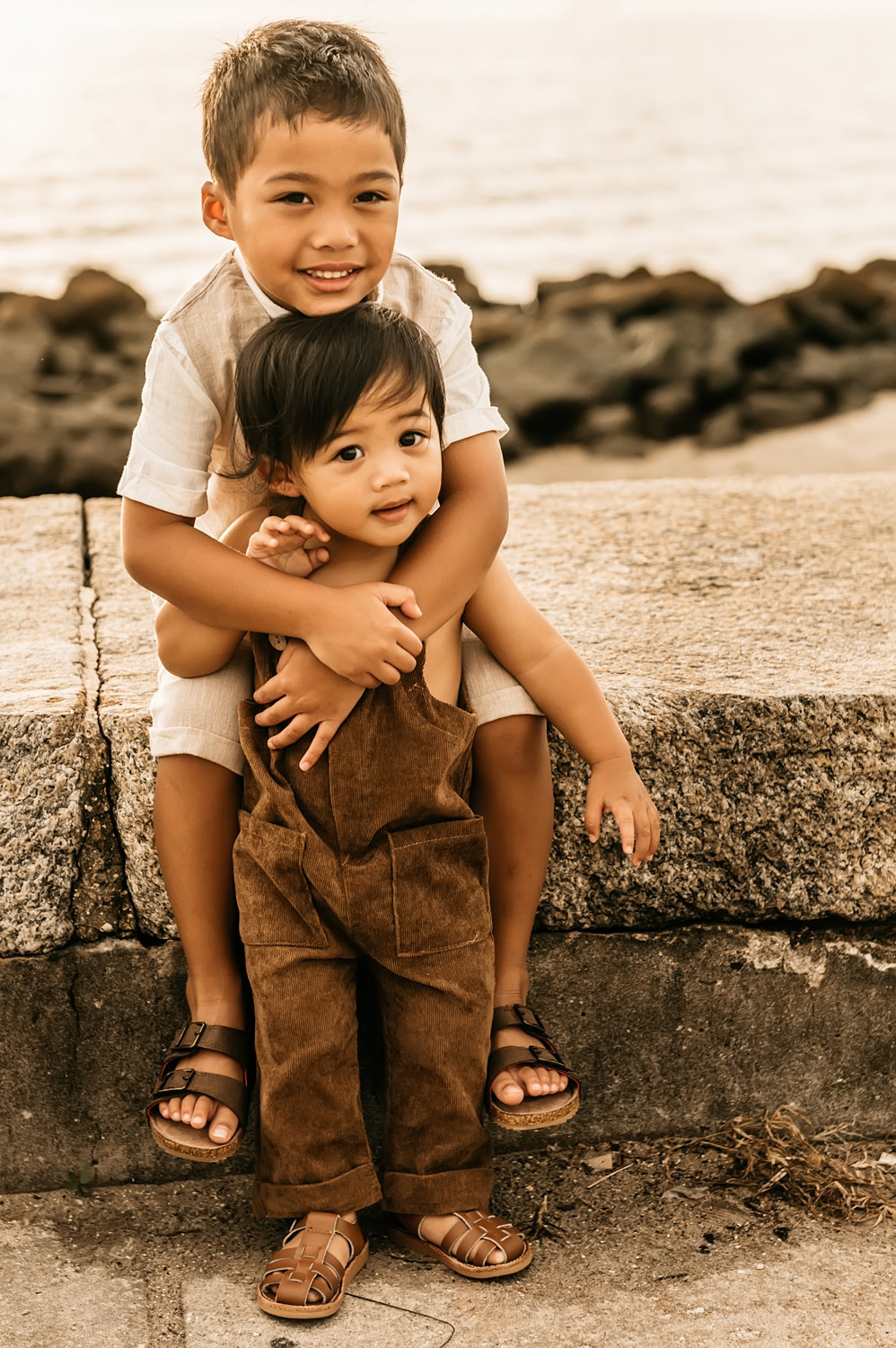 two young brothers wearing neutral colors and brown sandals, Saint Augustine family photographer