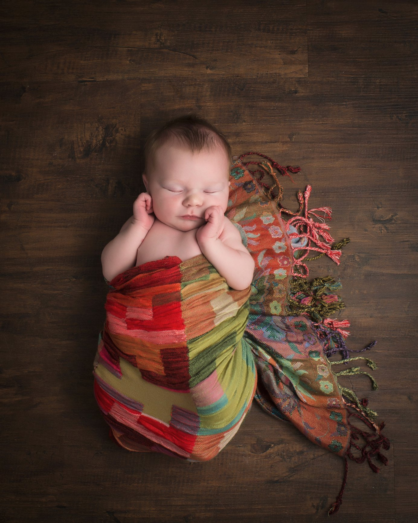 We specialize in artistic newborn portraits that look great on any wall of your home not just the nursery