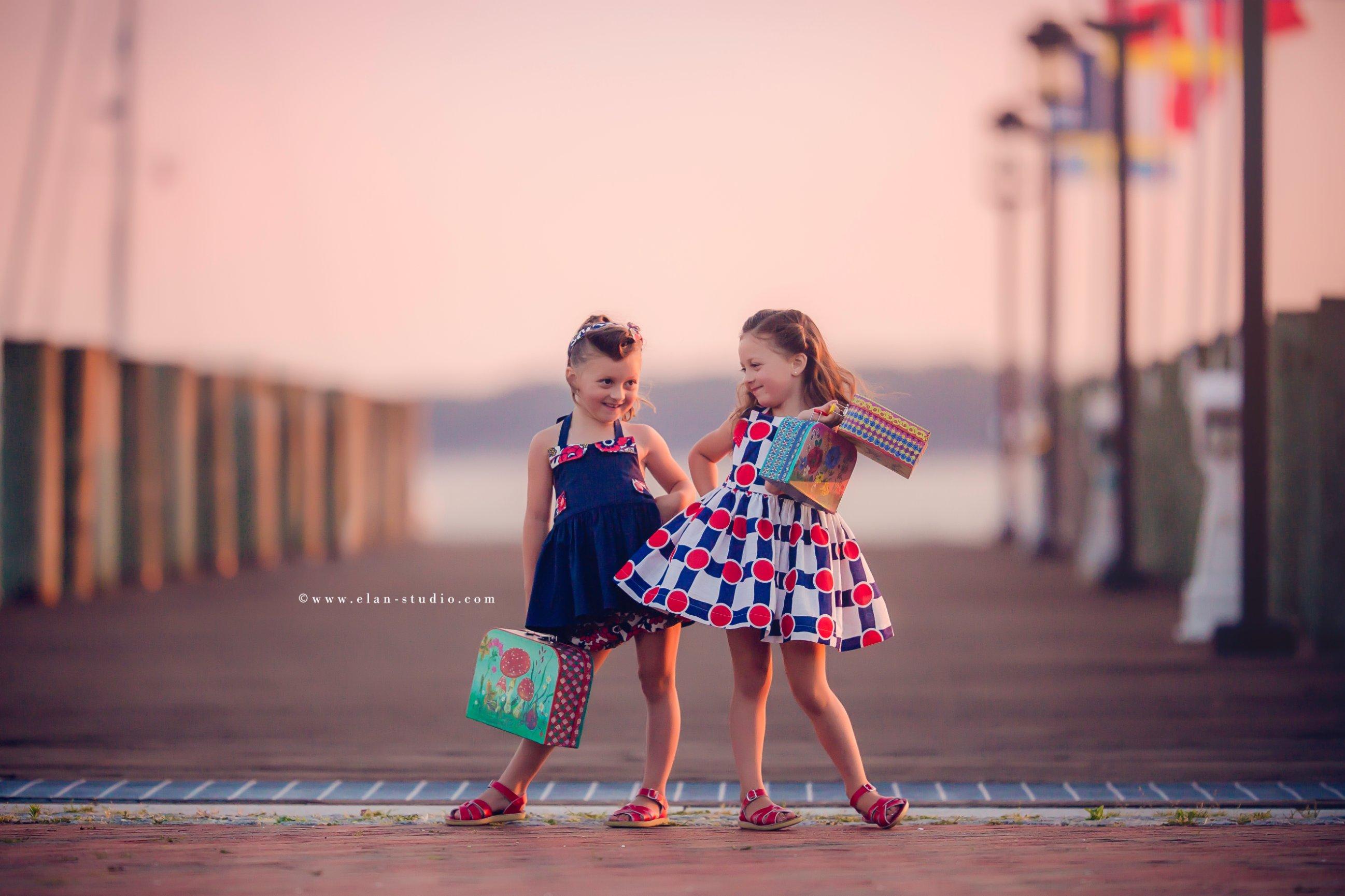 vintage beach photoshoot, two sisters, victory rolls hair, vintage girls dresses
