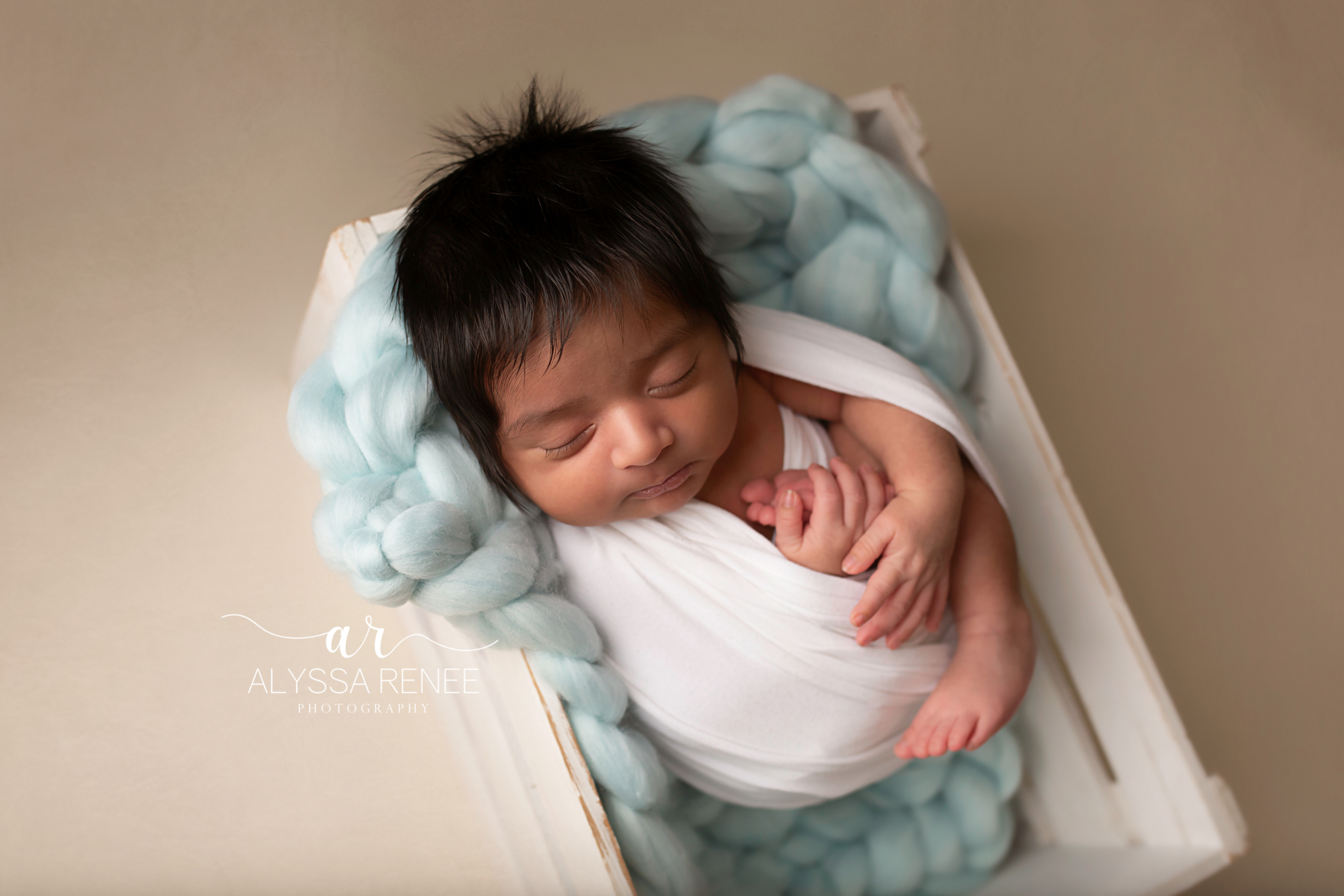 Baby portrait swaddled in box with handmade blue blanket prop